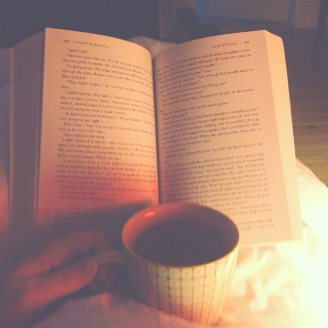 reading a book and drinking tea