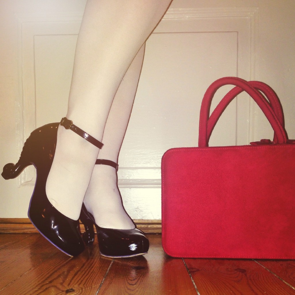 black anna sui shoes and red vanity case